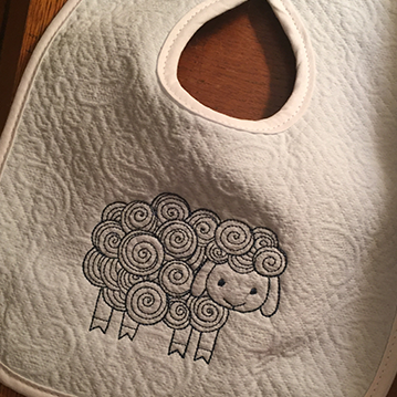 embroidered lamb on a bib