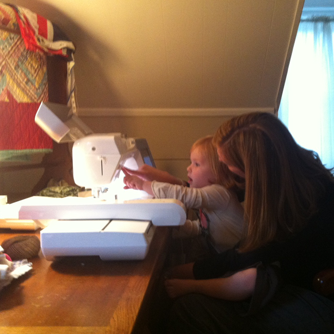 mother and daughter in front of a sewing machine