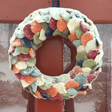 wool wreath covered in snow
